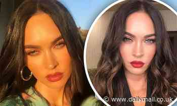 Megan Fox looks absolutely radiant as she works glossy red lips and smokey eye shadow