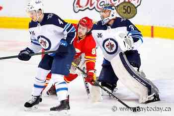 Jets beat Flames 4-0 to snap seven-game losing streak and clinch playoff spot