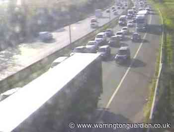 Long delays on M6 north near Winwick after lane closed