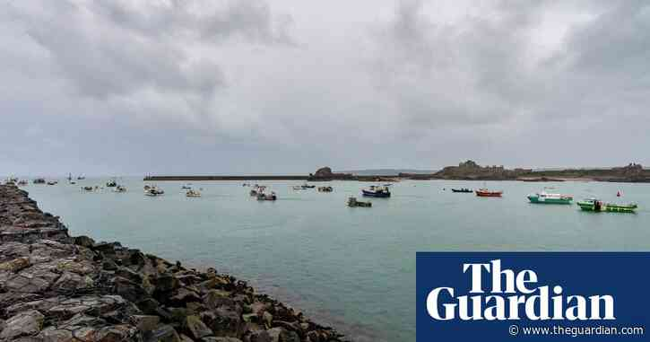Dozens of French boats gather at Jersey port in protest – video
