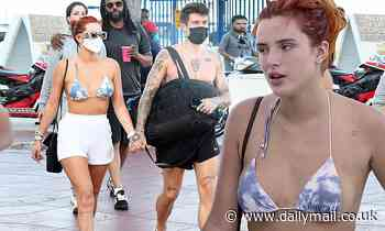 Bella Thorne models cloudy sky bikini top as she holds hands with shirtless fiance Benjamin Mascolo