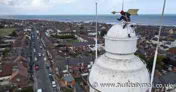 Striking drone shots capture brave painter on top of 130ft lighthouse - Hull Live