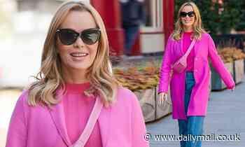 Amanda Holden puts on a vibrant display as she rocks a fuchsia coat while leaving Heart FM