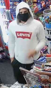 Masked man threatened Accrington shopkeeper before escaping with stash of cash and cigs