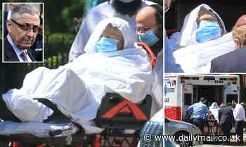 Sheldon Silver is seen wrapped in sheets on a stretcher headed back to prison