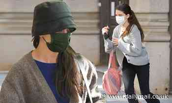 Katie Holmes is an NYC fashionista in a leather hat as she and daughter Suri Cruise, 15, step out