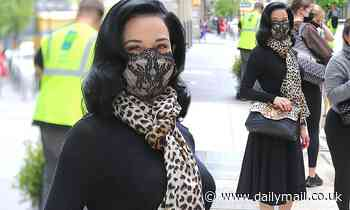 Dita Von Teese looks effortlessly chic in stylish black dress as she steps out in New York