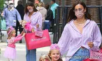 Irina Shayk puts tiara on Lea De Seine, four, as she takes her shopping for an American Girl doll