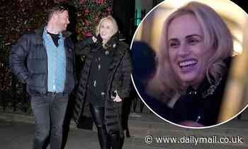 Giggling Rebel Wilson gets an admiring glance from a male companion following her 70lb weight loss