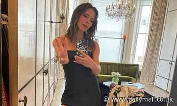 Victoria Beckham, 46, returns to her Posh Spice roots as she flashes a peace sign in a black dress