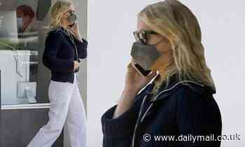 Gwyneth Paltrow looks summery in white slacks as she chats on phone while shopping in Santa Monica - Daily Mail