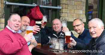 People of Liverpool brave the weather to enjoy a drink