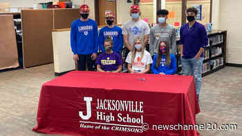 Eight Jacksonville students sign to continue their athletic careers in college - newschannel20.com