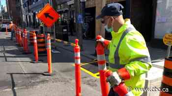 Crews begin to block off curb lanes for CaféTO as city prepares to bring back popular program