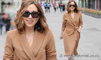 Myleene Klass wears a beige wrap-front coat as she arrives at Global Radio studios