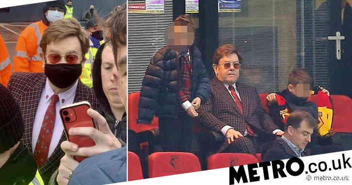 Elton John enjoys family day out with sons as they cheer beloved Watford to victory
