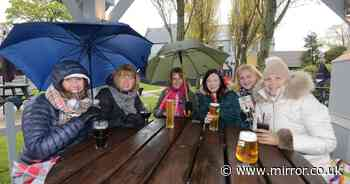 Brits brave heavy rain and winds to hit pub beer gardens in weekend washout