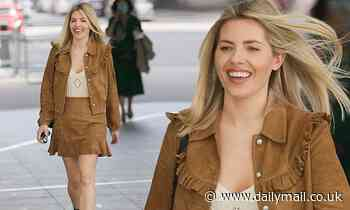 Mollie King has a spring in her step as she bounds into work in a cowgirl-esque brown suede co-ord
