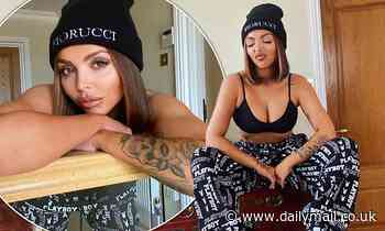Jesy Nelson sizzles in a plunging black bra and monochrome Playboy tracksuit bottoms