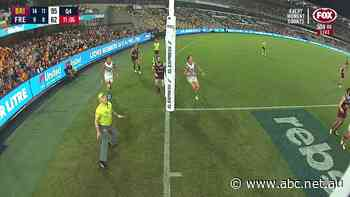 'That is awesome': Goal umpire stands his ground as players fly in