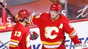 Flames blowout Sens to keep flickering playoff hopes alive
