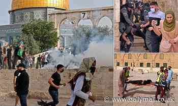 Israeli police fire tear gas and stun grenades at Palestinian protesters on Temple Mount