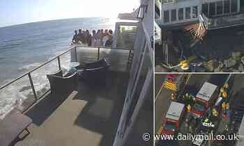 Horrifying moment packed Malibu beach house balcony collapses on to rocks below leaving two injured