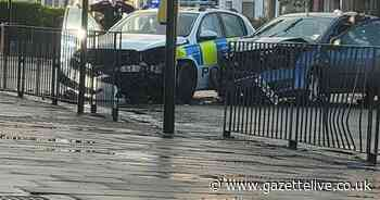 Police car involved in nasty two-car smash at busy junction