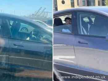 Police share photos of driver smiling in back of driverless Tesla