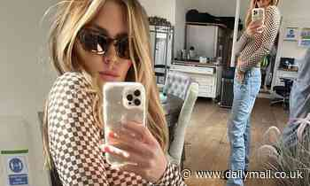 Abbey Clancy highlights her lithe frame in a cropped checkerboard top and platform shoes