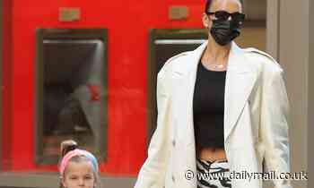 Irina Shayk flaunts taut tummy in zebra-print pants while strolling with daughter Lea in NYC