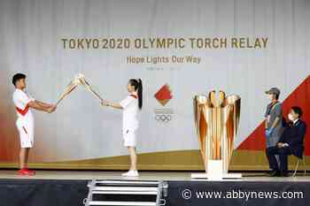 Tokyo Olympic torch relay pulled off streets as COVID-19 cases rise