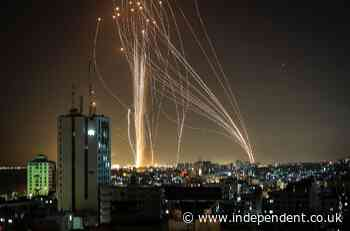 Israel news – live: One woman killed in rocket attack on Tel Aviv as Iron Dome tries to intercept bombardment