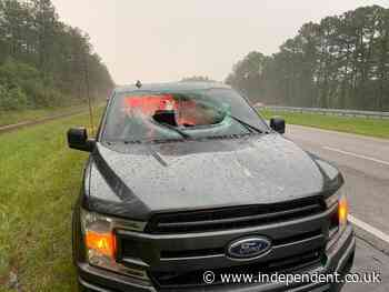 Lightning strike sends chunk of road flying into truck's windshield, injuring two