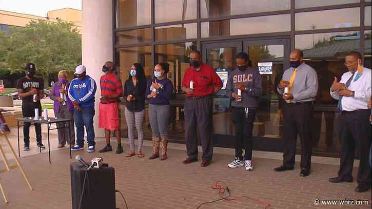 Friends, teachers and students hold candle light vigil in memory of killed SU professor