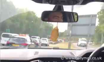 Motorist filmed driving down the central reservation of a dual carriageway