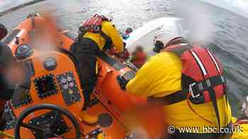 Adults and children rescued from overturned dinghy and paddleboards