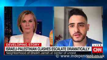 Palestinian campaigner removed from Sheikh Jarrah after CNN interview