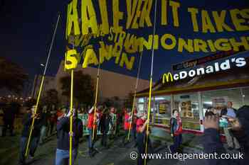 McDonald's raises minimum pay at corporate locations as workers in 15 cities plan strikes for $15 hourly wage