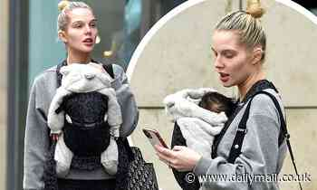Helen Flanagan goes makeup free for a stroll with her baby son Charlie in Manchester