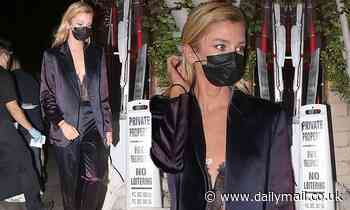 Stella Maxwell wears purple suit and low-cut lace top for dinner with friends in LA