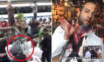 Moment bloodied man has to flee crowd during protest in Manhattan after making 'hateful comments'