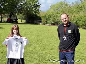 Sadie, 11, re-brands Sutton upon Derwent School uniform