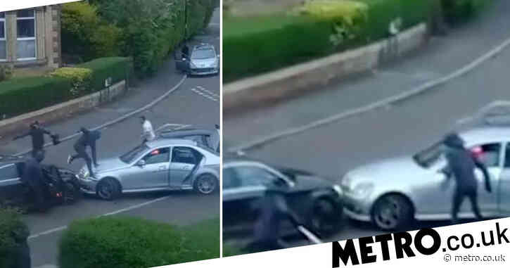 Men armed with baseball bats pile into getaway car after terrifying attack
