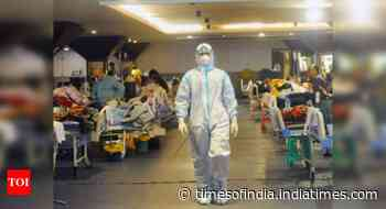 Coronavirus live updates: India's Covid cases dip to 3.2 lakh, toll remains high at 3,883 - Times of India