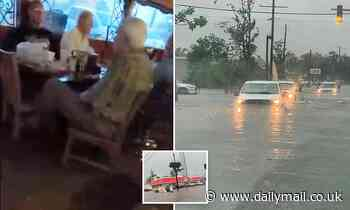 Louisiana residents are warned to stay off the roads after flash flooding submerges cars