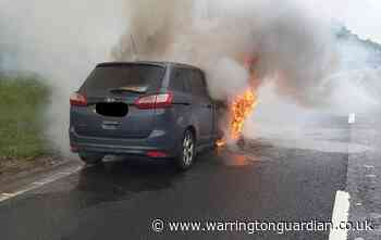Dramatic photos of car fire which caused delays on M62