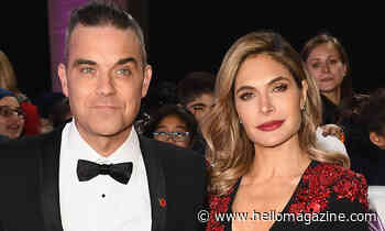 Robbie Williams is every inch the doting dad in heart-melting photo with both daughters - HELLO!