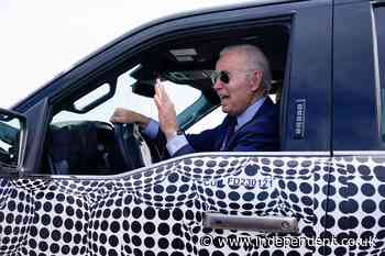 Biden back behind the wheel, zooming away in electric truck