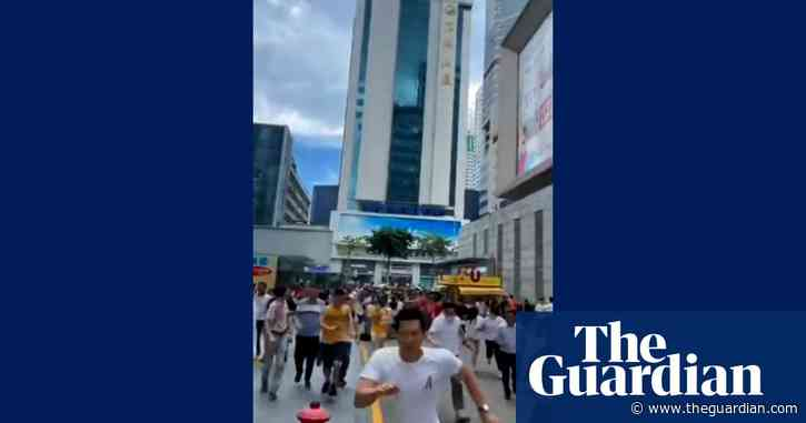 People flee in panic as 300-metre skyscraper wobbles in China – video